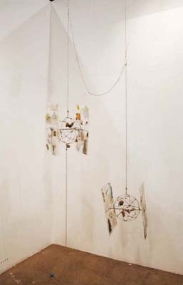 Eduardo Abaroa, The Third World Loves Star Wars, Too, 2009. Steel wire, laminated plastic, hot glue, collage, galvanized steel chain, miniature globes, dimensions variable.