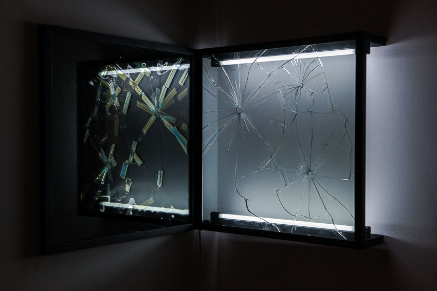 Pablo Rasgado. Afterimage (Repaired Broken Mirror #2), 2014. Welded steel, mirror, filters and fluorescent light, 19 1/2 x 19 1/2 inches