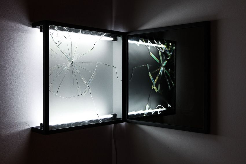 Pablo Rasgado. Afterimage (Repaired Broken Mirror #3), 2014. Welded steel, mirror, filters and fluorescent light, 19 1/2 x 19 1/2 inches