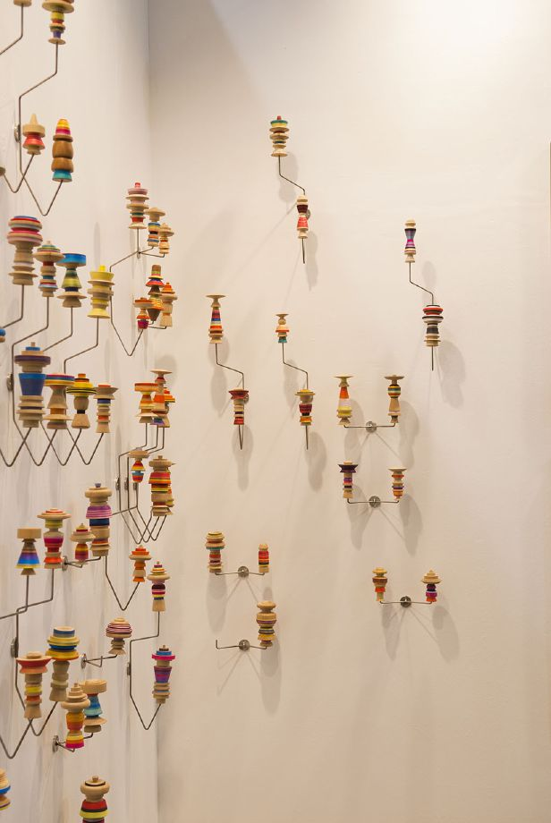 Edgar Orlaineta. Hang-them-all, 2014 Stainless steel, turned wood and color thread Dimensions variable (60 racks with 120 Katsinas) (detail)