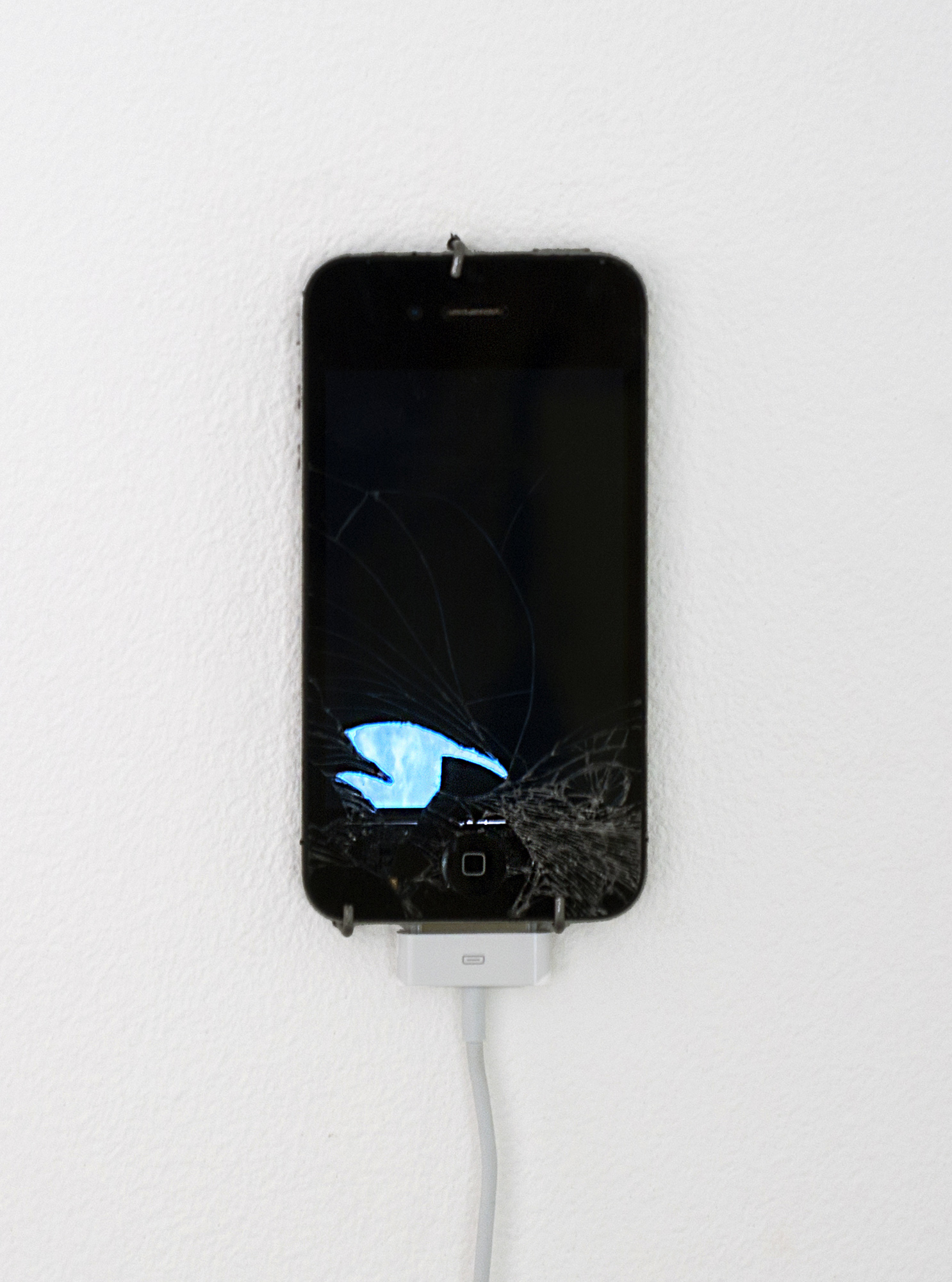 Émilie Brout & Maxime Marion. <em>Return of the Broken Screens (Apple iPhone 4)</em>, 2015. Broken found smart-phone, video, 4 3/4 x 2 1/4 inches (12.1 x 5.7 cm)