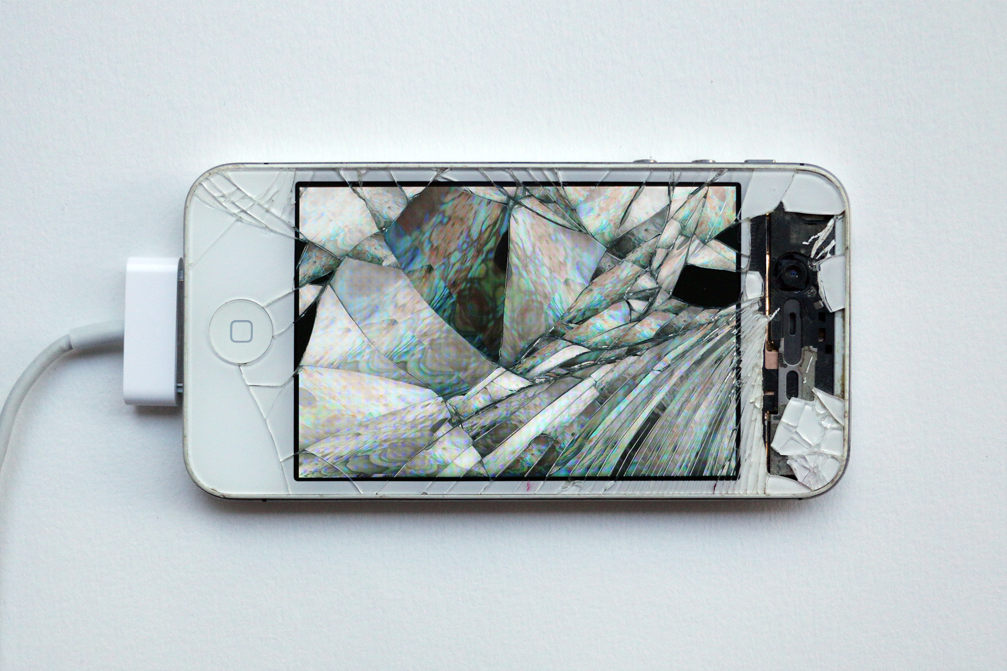 Émilie Brout & Maxime Marion. <em>Return of the Broken Screens (Apple iPhone 4 II)</em>, 2016. Broken found smart-phone, video, 4 3/4 x 2 1/4 inches (12 x 5.7 cm)