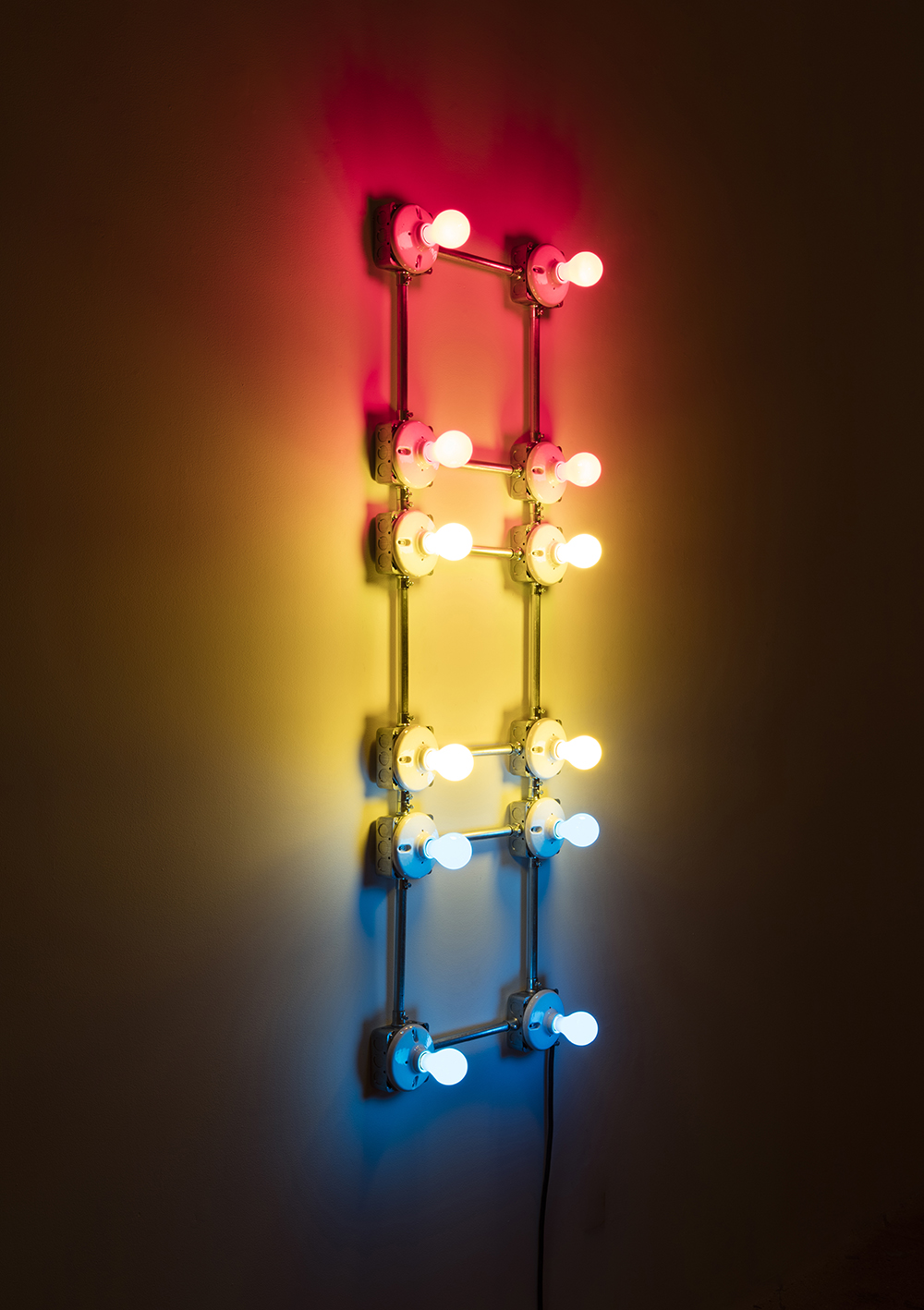 G.T. Pellizzi. <em>Conduits in Red, Yellow and Blue (Figure 67)</em>, 2016. Galvanized steel, copper wire, porcelain fixtures and ceramic coated light bulbs, 54 x 18 inches