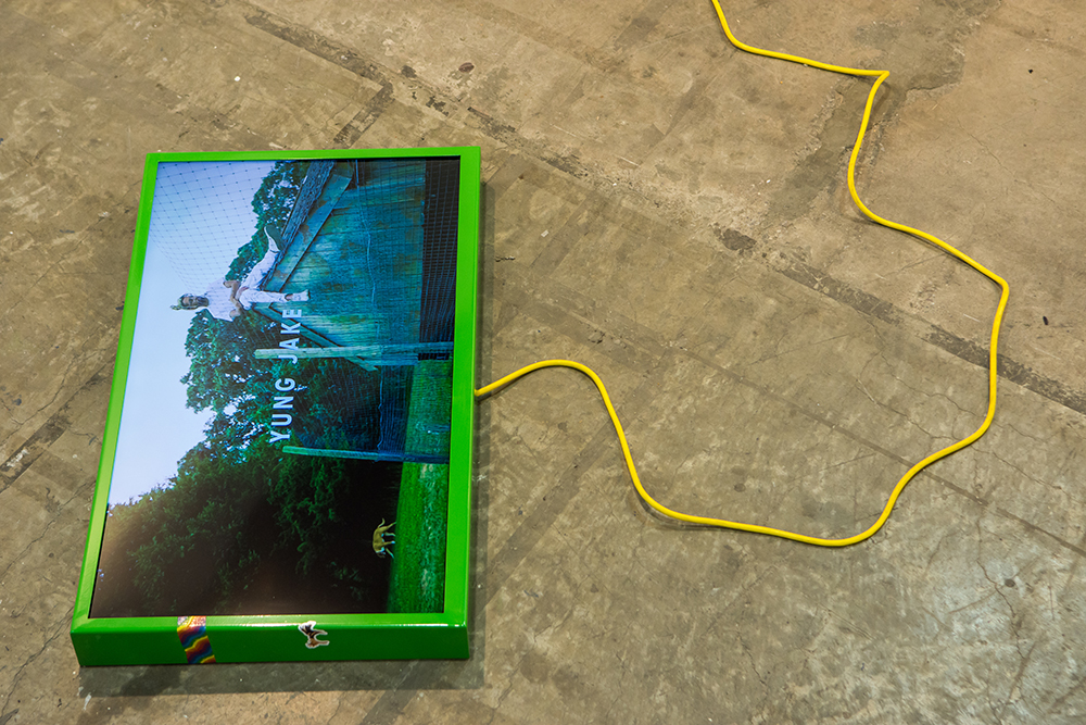 <em>off top</em>, 2017. Digital video, monitor, spray paint, Model Magic ®, sticker and ink on powder coated steel and extension cord, Length: 3 minutes, 2 seconds, 27 x 45 x 4 inches