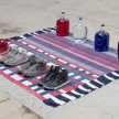 Amanda Ross-Ho and Diedrick Brackens. <em>Untitled Floor Arrangement (300 bucks would save my life)</em>, 2017. Handwoven cotton rugs, glass jugs, Procion dyes, Nike Dunks, and Reebok Pumps, 12 1/4 x 64 1/2 x 48 inches thumbnail