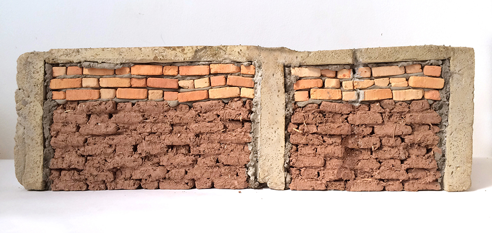 Ximena Garrido-Lecca. <em>Paredes de Progreso: Andino / Walls of Progress: Andean</em>, 2013. Mud, straw, cement, fired bricks and acrylic, 6 5/16 x 19 1/2 x 1 9/16 inches