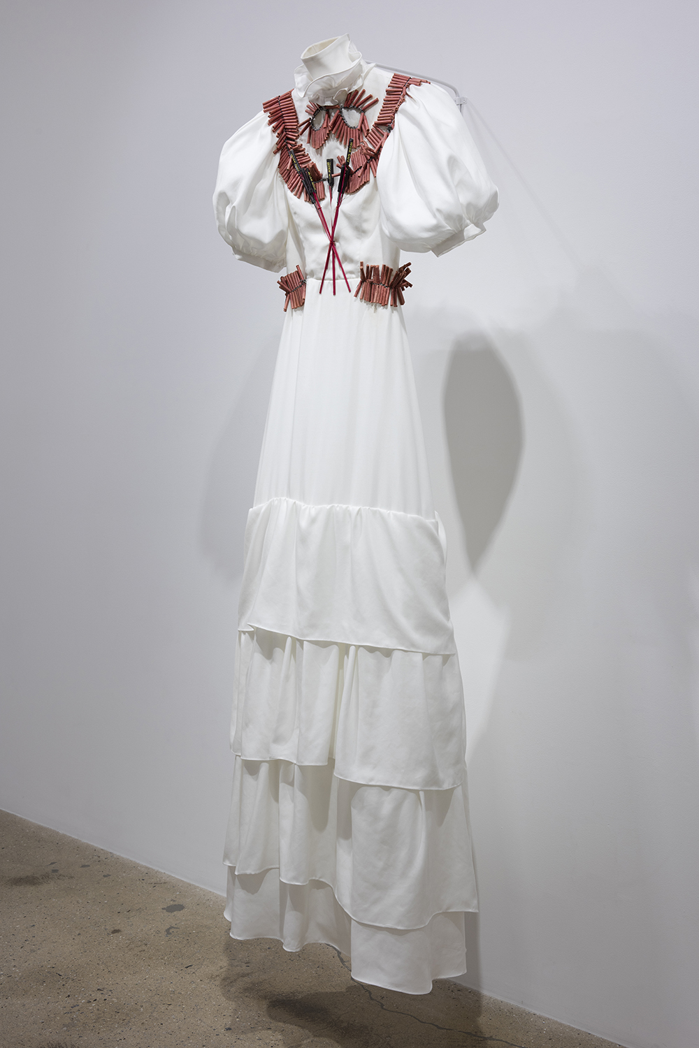 Audrey Wollen. <em>Only Detonate</em>, 2017. Cotton dress and fireworks, 76 x 27 x 8 inches