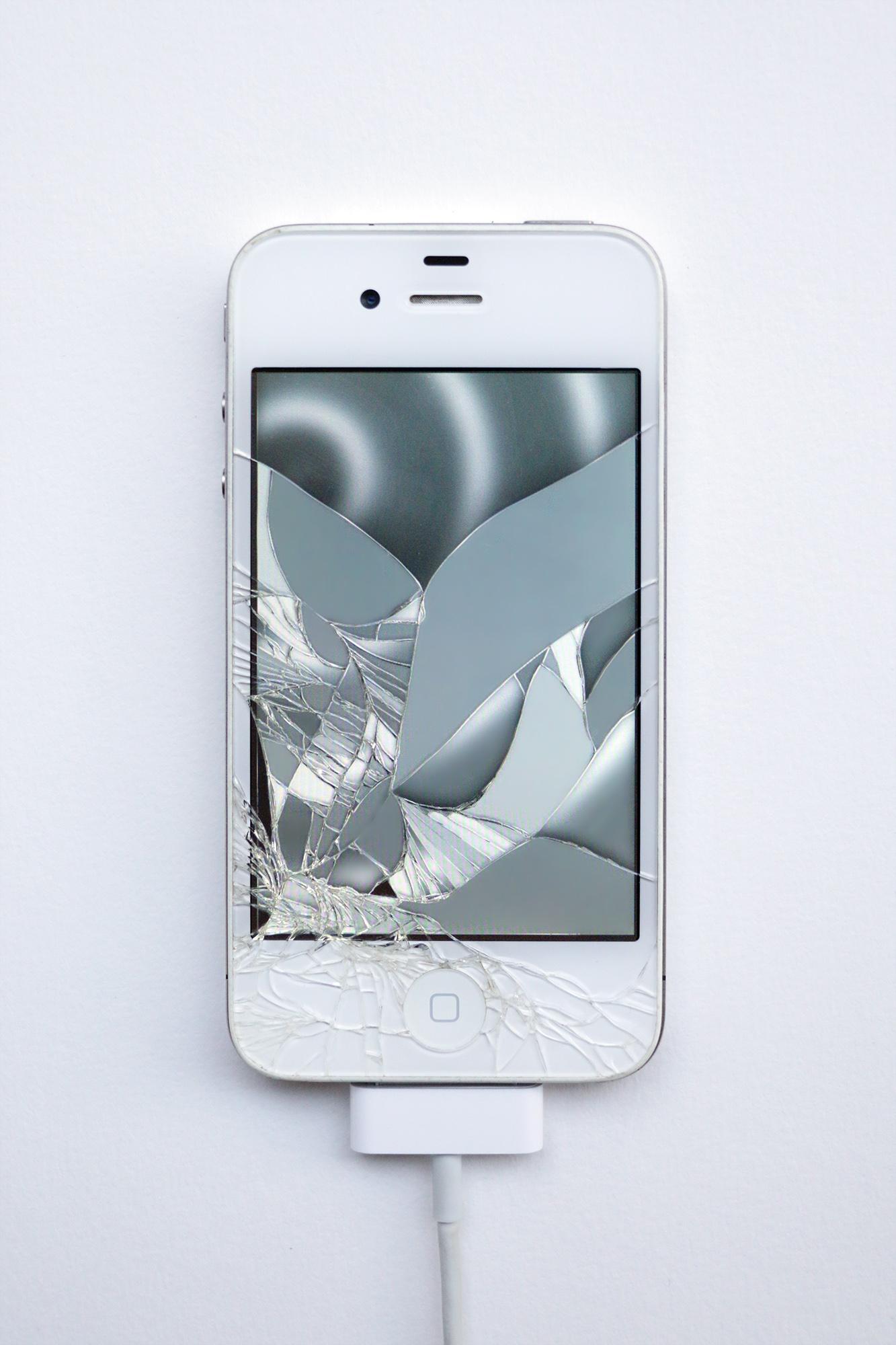 <em>Return of the Broken Screens (Apple iPhone 4 II)</em>, 2016.  Broken found smart phone, video, 4 3/4 x 2 1/4 inches