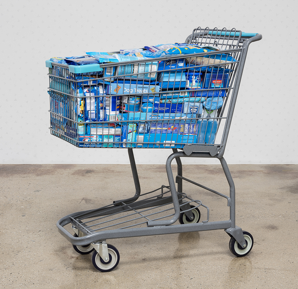 Adriana Martinez. <em>CMYK</em>, 2017. Metal shopping carts, plastic, spray paint and packed groceries, 41 x 25 x 32 inches (104.1 x 63.5 x 81.3 cm)