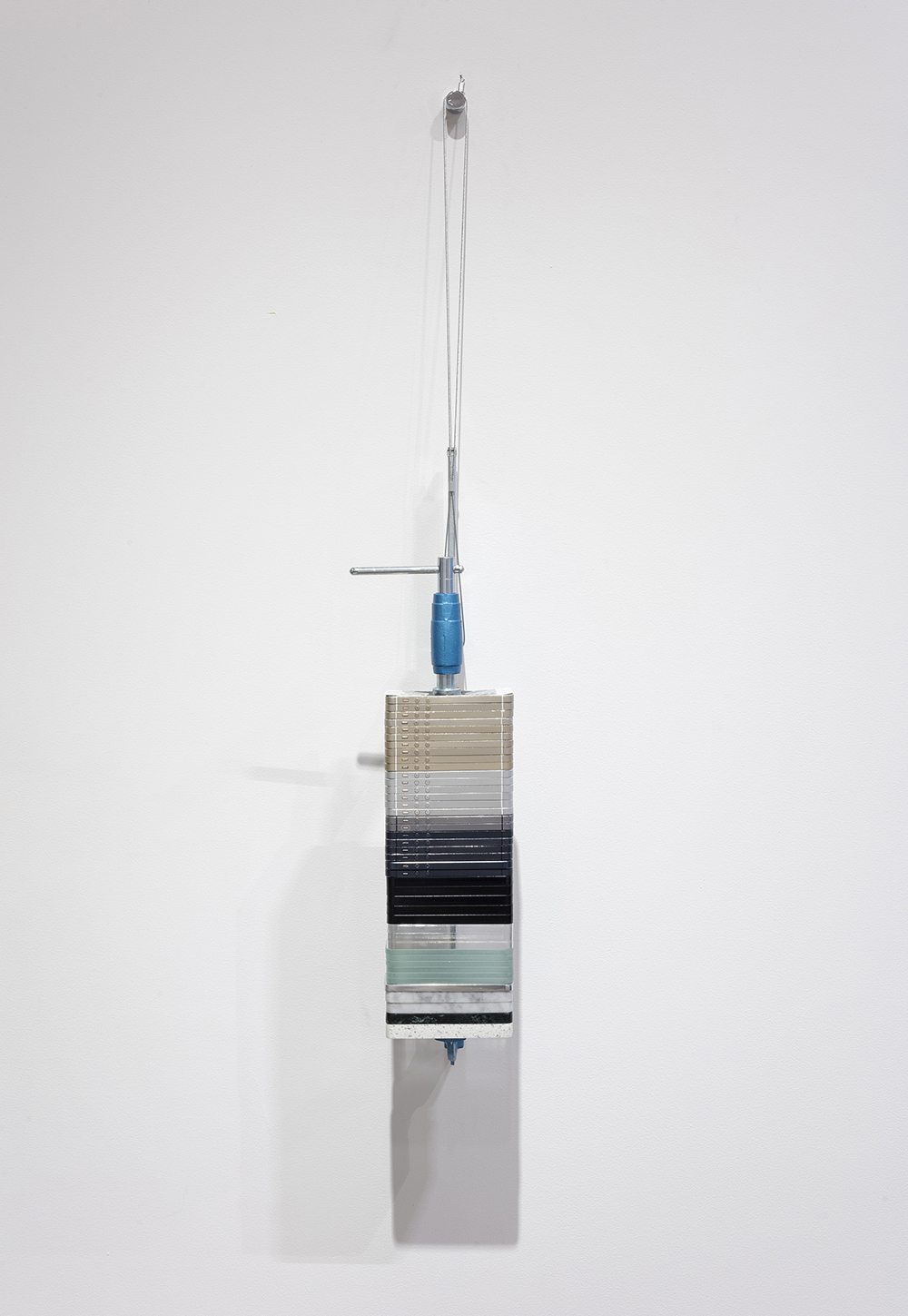 Mariana Murcia. <em>Save As 2</em>, 2017. Clamp, granite, marble aluminum plexiglass cases and Iphone 5s, 24 x 5 x 5 inches (61 x 12.7 x 12.7 cm)