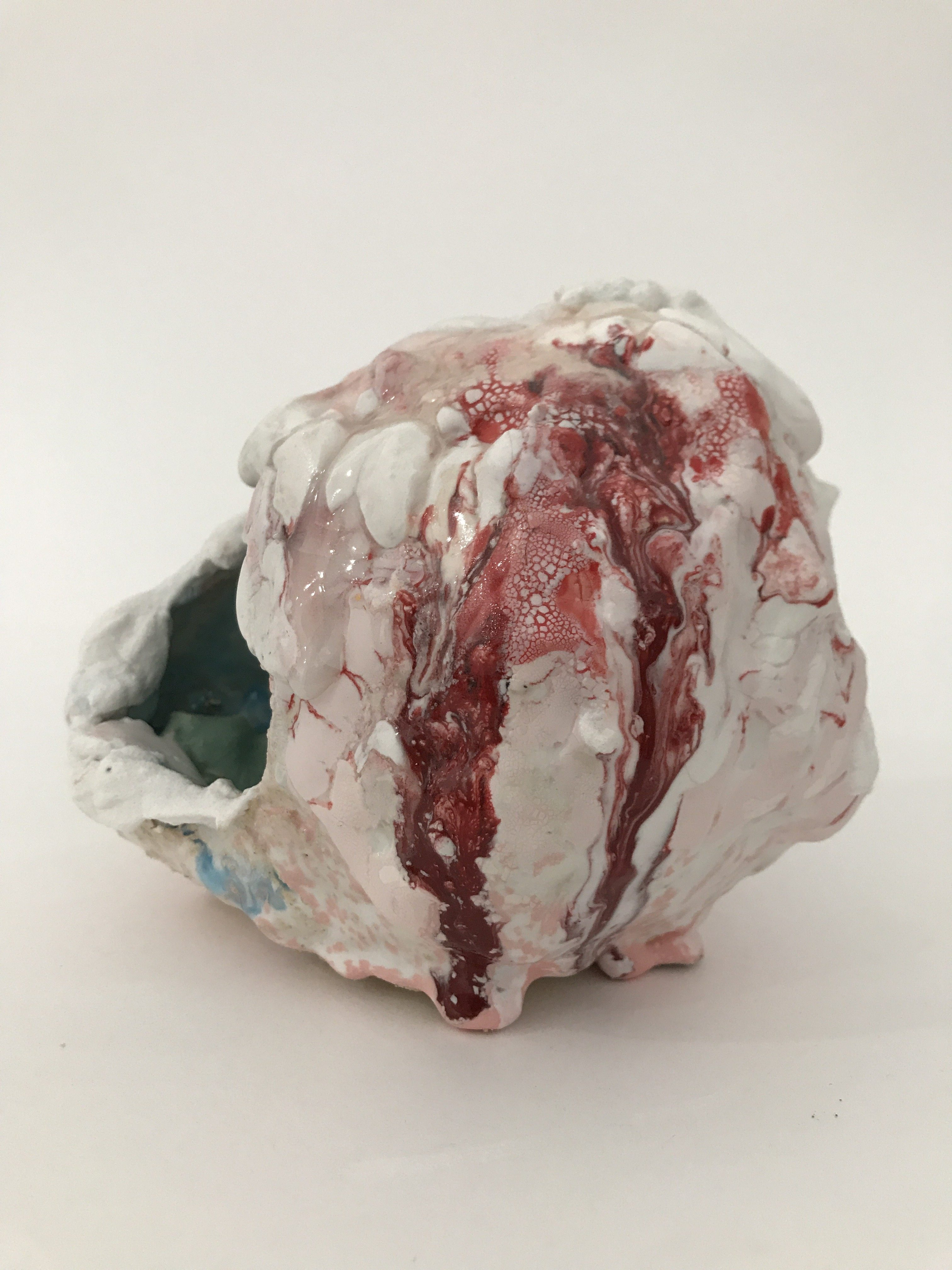 Brian Rochefort. <em>Skull (red, white, black)</em>,  2017. Terra cotta, glaze and glass fragments, 7 x 5 x 7 inches (17.8 x 12.7 x 17.8 cm)