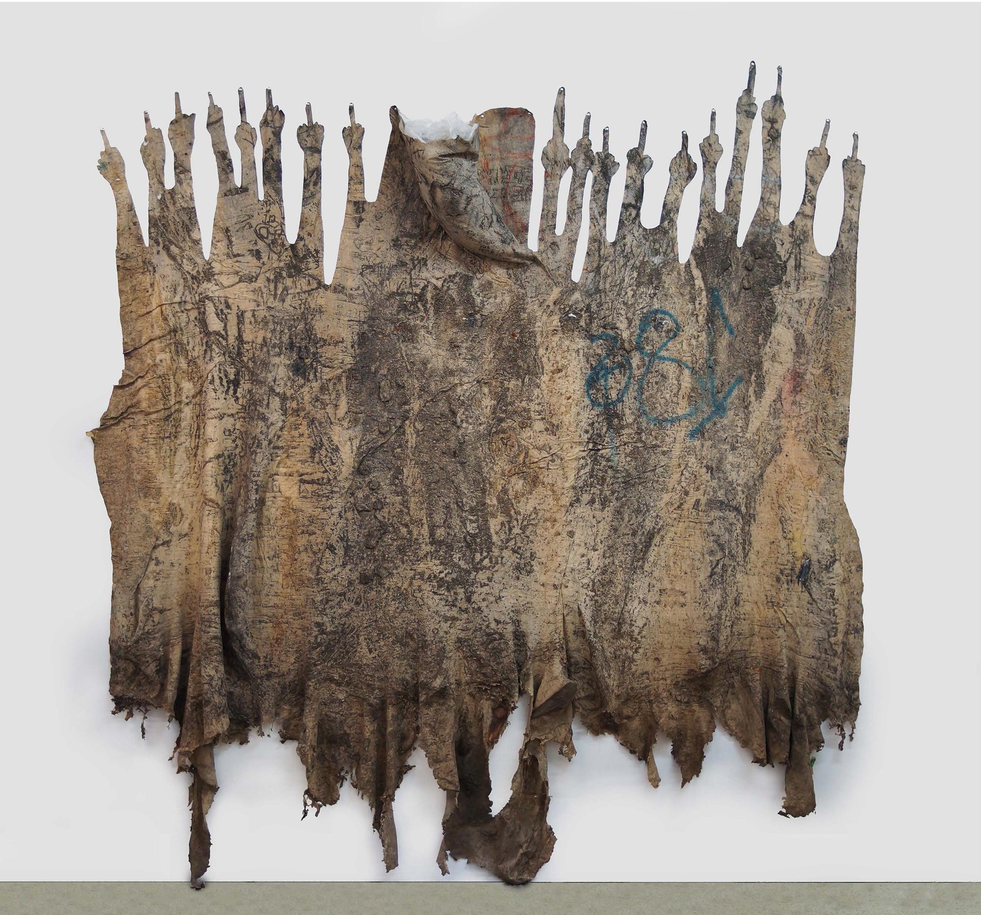 Eddie Rodolfo Aparicio. <em>Aquellos Que Apuntan Con El Dedo Medio (11th and Union Streets, Los Angeles, California)</em>, 2017. Rubber, sulfur, resin, tree and paint residue on cotton, 102 x 180 x 6 inches (259.1 x 457.2 x 15.2 cm)