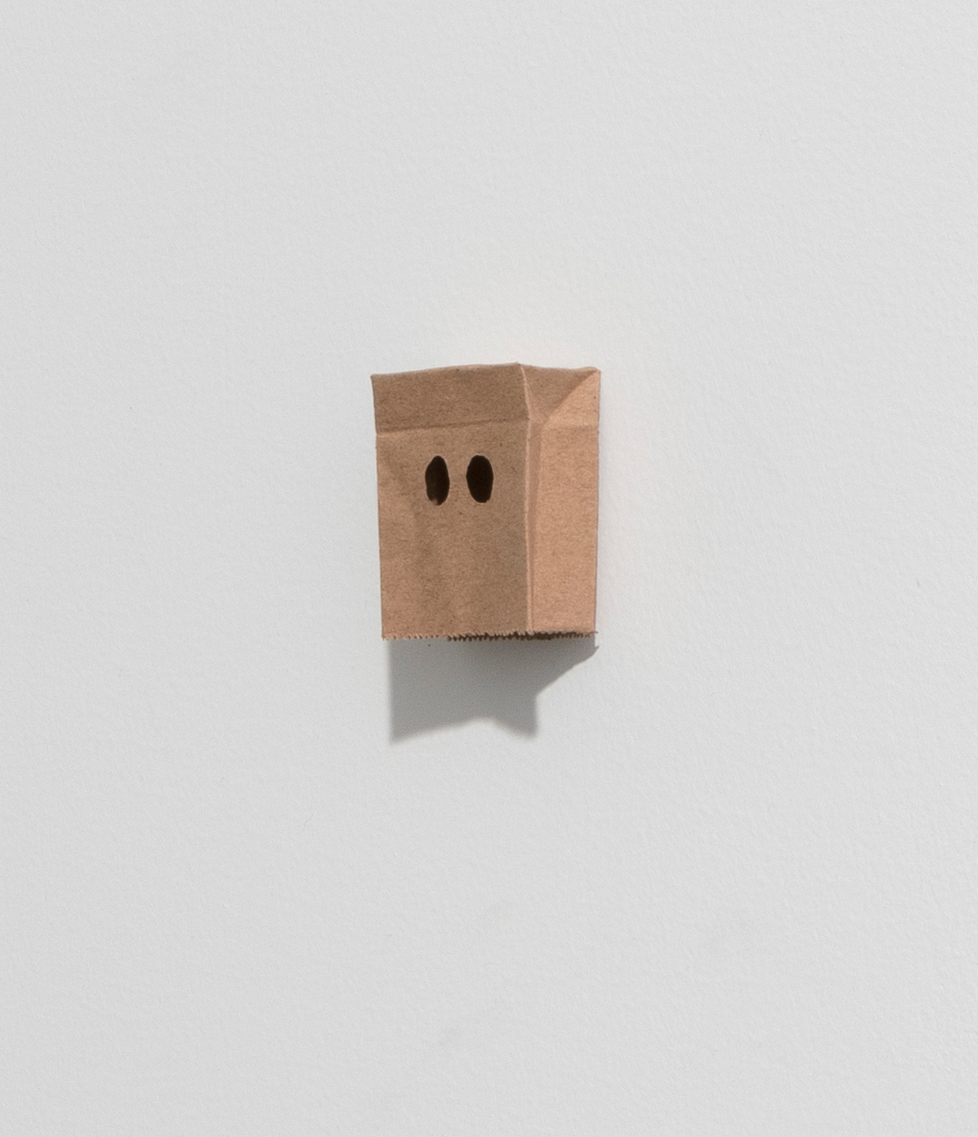 Nick Doyle. <em>Shame</em>, 2019. Re-purposed paper bag, pva adhesive, 1 3/4 x 1 1/4 x 1/2 inches  (4.4 x 3.2 x 1.3 cm)