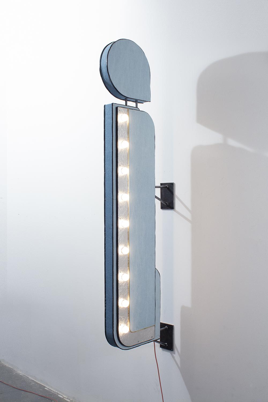 Nick Doyle.<em>i</em>, 2019. Marquee lightbulbs, electrical wire, tinfoil, brass, denim, plywood and steel, 67 1/2 x 18 x 6 inches (171.5 x 45.7 x 15.2 cm)