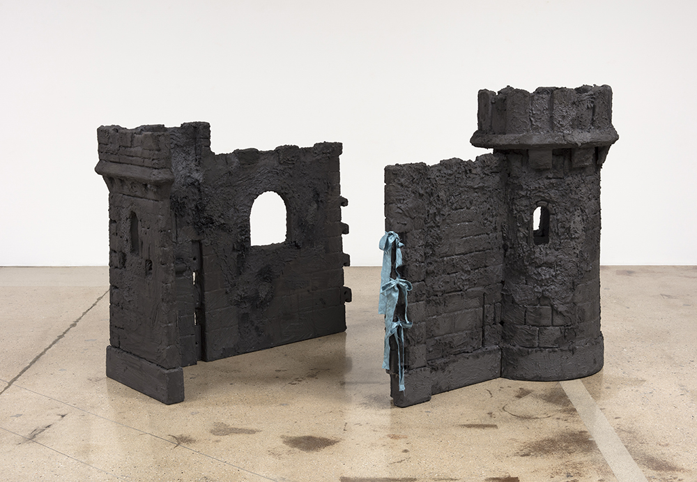 Alix Vernet. <em>Ruin<em>, 2019. Grout on plastic castle, 55 x 55 x 55 inches (139.7 x 139.7 x 139.7 cm)