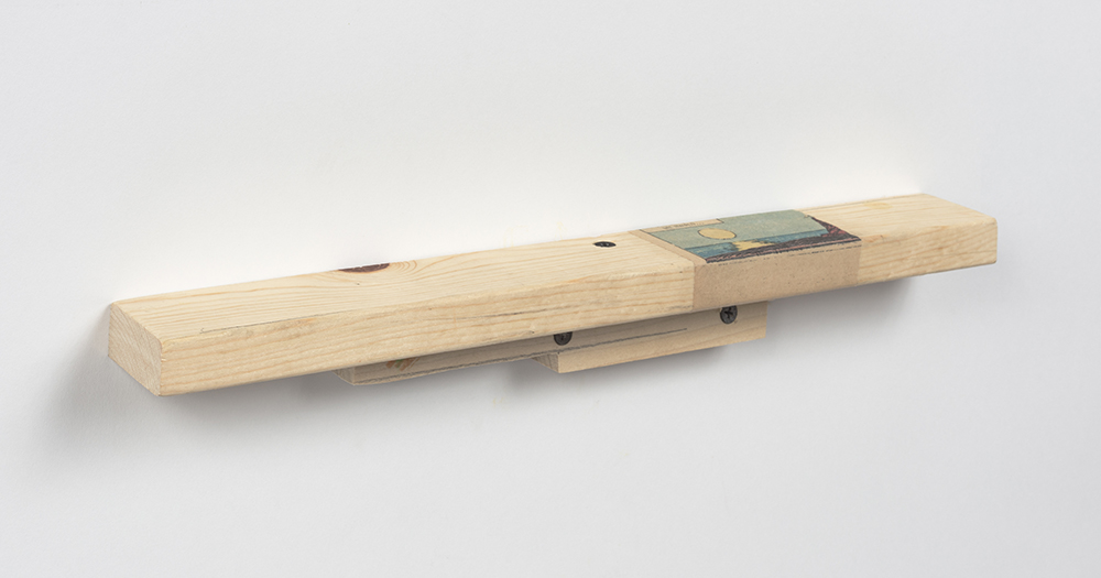 Kevin McNamee-Tweed.<em> Dayender</em>, 2019. Newsprint on wood, 1 3/4 x 15 x 1 3/4 inches (4.4 x 38.1 x 4.4 cm)