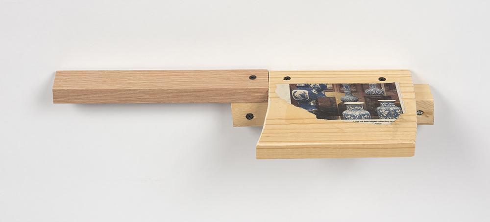 Kevin McNamee-Tweed.<em> Fine</em>, 2019. Newsprint on wood, 2 1/4 x 17 x 5 1/2 inches (5.7 x 43.2 x 14 cm)