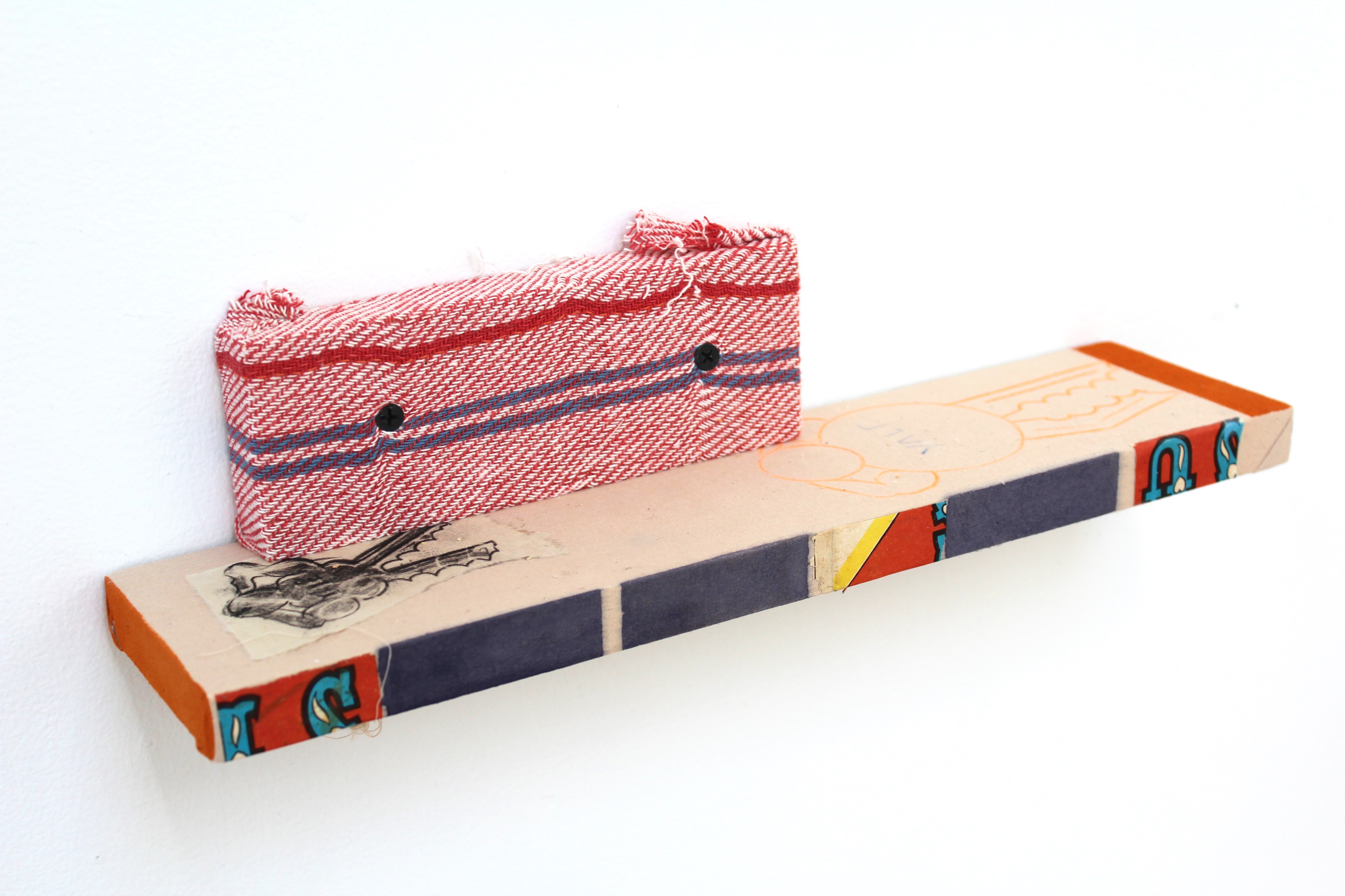 Kevin McNamee-Tweed.<em> Astrud Shelf</em>, 2019. Ink on wood with fabric, pencil on paper drawing, and affixed newsprint, 3 1/4 x 14 1/4 x 3 1/2 inches  (8.3 x 36.2 x 8.9 cm)