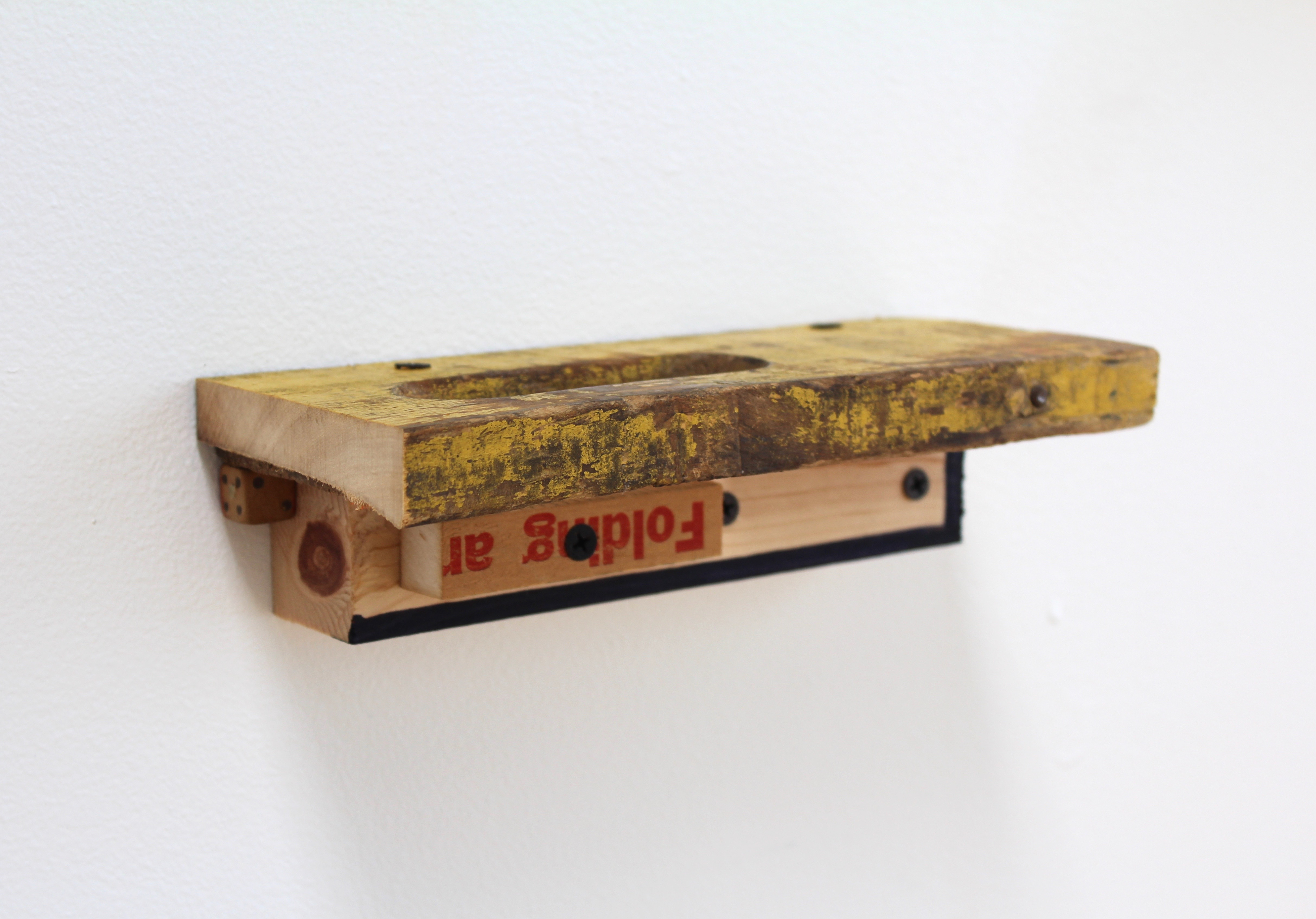 Kevin McNamee-Tweed.<em> Folding Shelf</em>, 2019. Ink on wood with affixed yardstick and found wood, 2 1/4 x 8 1/2 x 3 3/4 inches (5.7 x 21.6 x 9.5 cm)