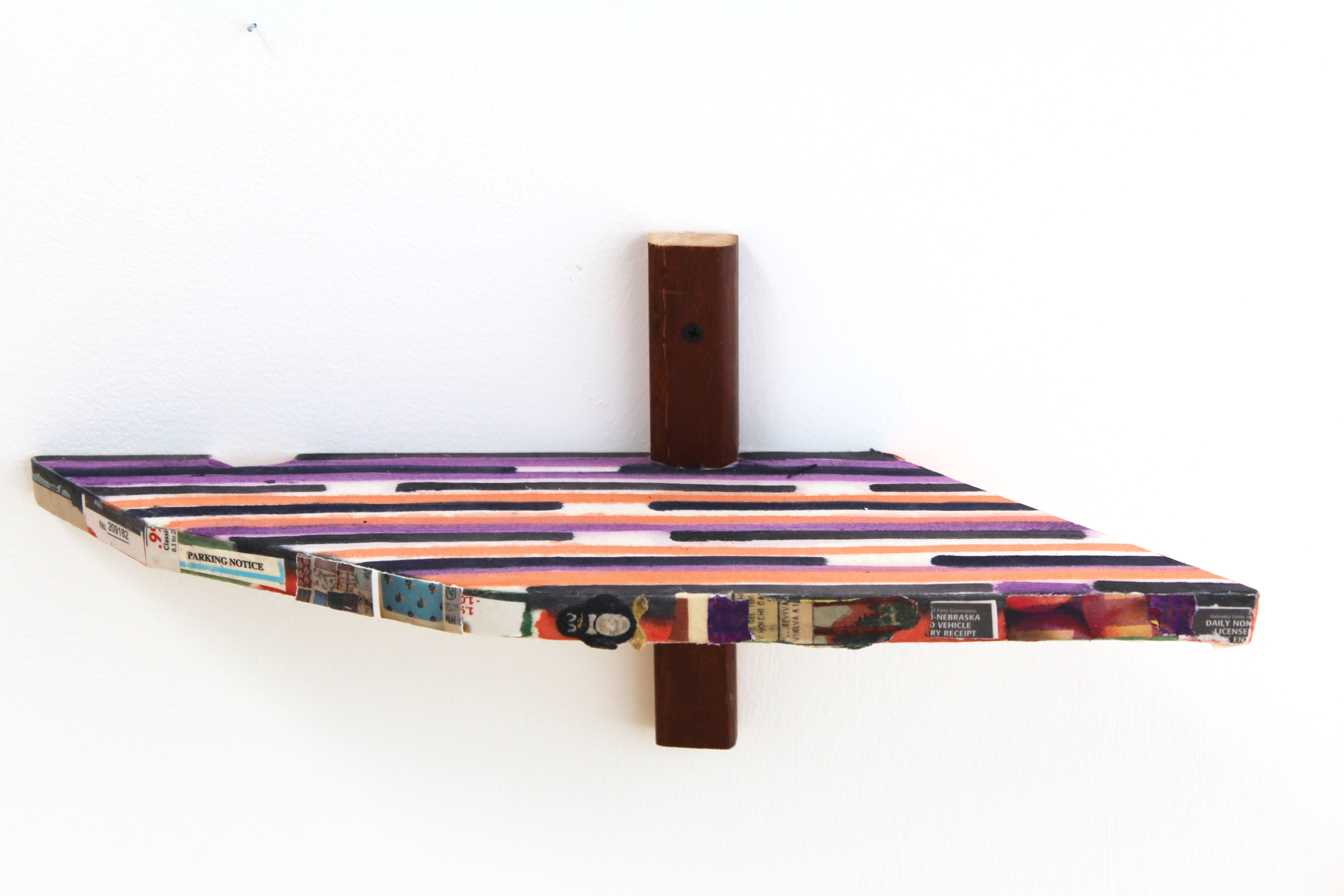 Kevin McNamee-Tweed.<em> Pen Shelf</em>, 2019. Ink on muslin mounted to wood with affixed newsprint, aluminum, and toy, 9 x 19 1/2 x 7 inches (22.9 x 49.5 x 17.8 cm)