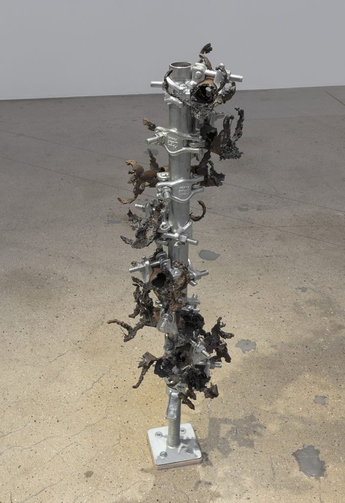 Luciana Lamothe. <em> Burning Inside</em>, 2019. Iron pipes and clamps, 45 x 12 x 12 inches (114.3 x 30.5 x 30.5 cm)