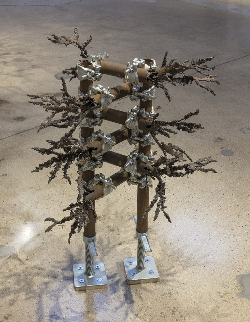 Luciana Lamothe. <em> Straight Burn, 1</em>, 2019. Iron pipes and clamps, 42 x 28 x 28 inches (106.7 x 71.1 x 71.1 cm)