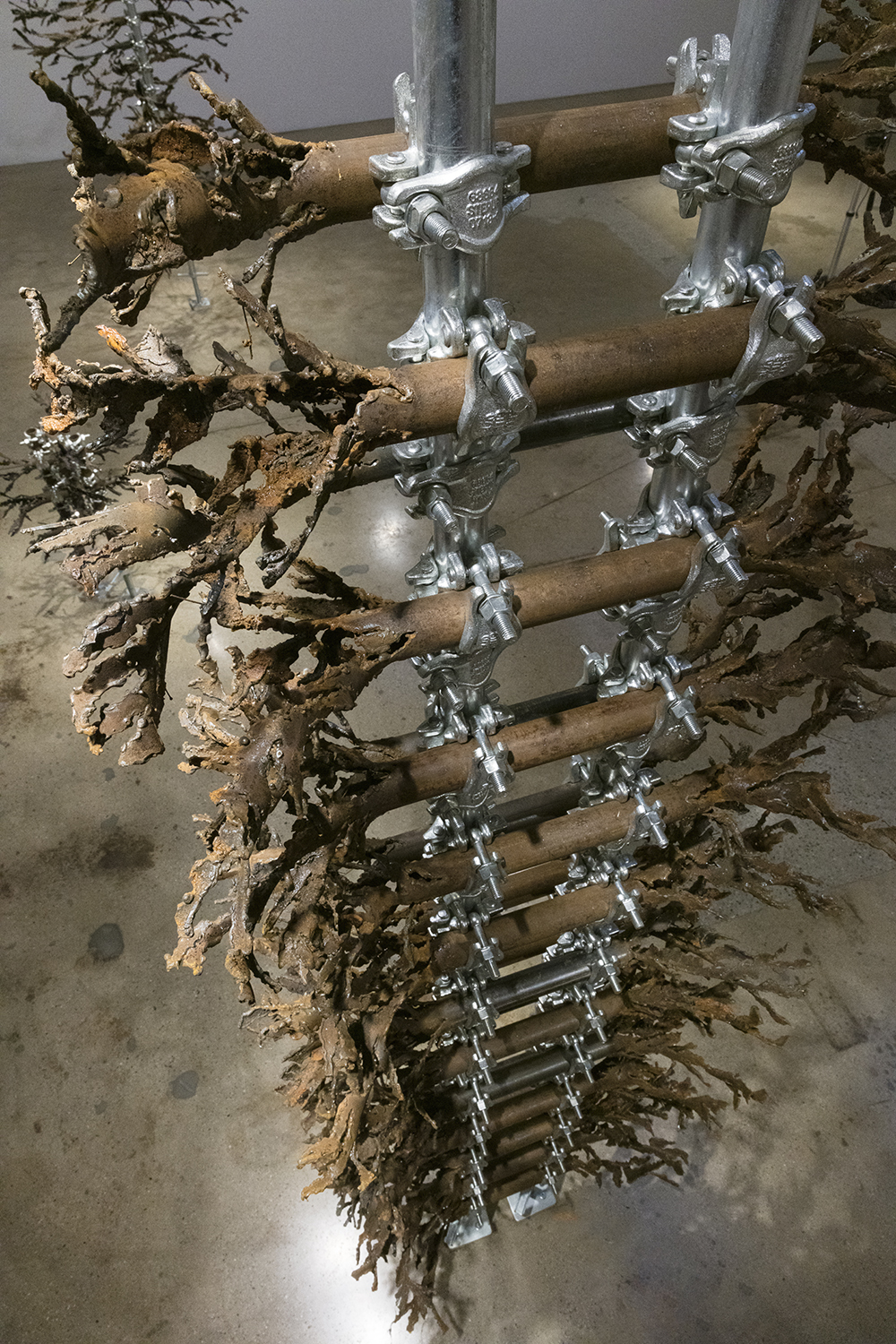 Luciana Lamothe. <em> Straight Burn, 2</em>, 2019. Iron pipes and clamps, 132 x 60 x 60 inches (335.3 x 152.4 x 152.4 cm) (detail)