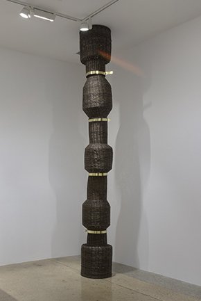 Eugenia Mendoza.<em> Bellow, No. 1 </em>, 2019. Bronze and wicker, 146 x 19 x 19 inches (370.8 x 48.3 x 48.3 cm)