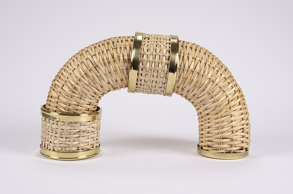 Eugenia Mendoza.<em> Bend</em>, 2019. Bronze and wicker, 13 x 19 5/8 x 5 7/8 inches (33 x 50 x 15 cm)