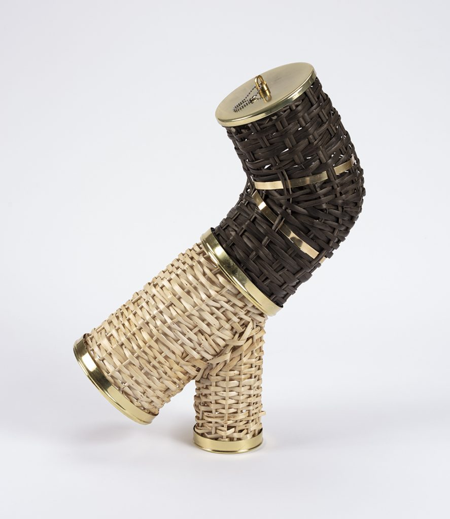 Eugenia Mendoza.<em> Y Tee & Elbow</em>, 2019. Bronze and wicker, 18 1/2 x 11 3/4 x 5 1/8 inches (47 x 30 x 13 cm)