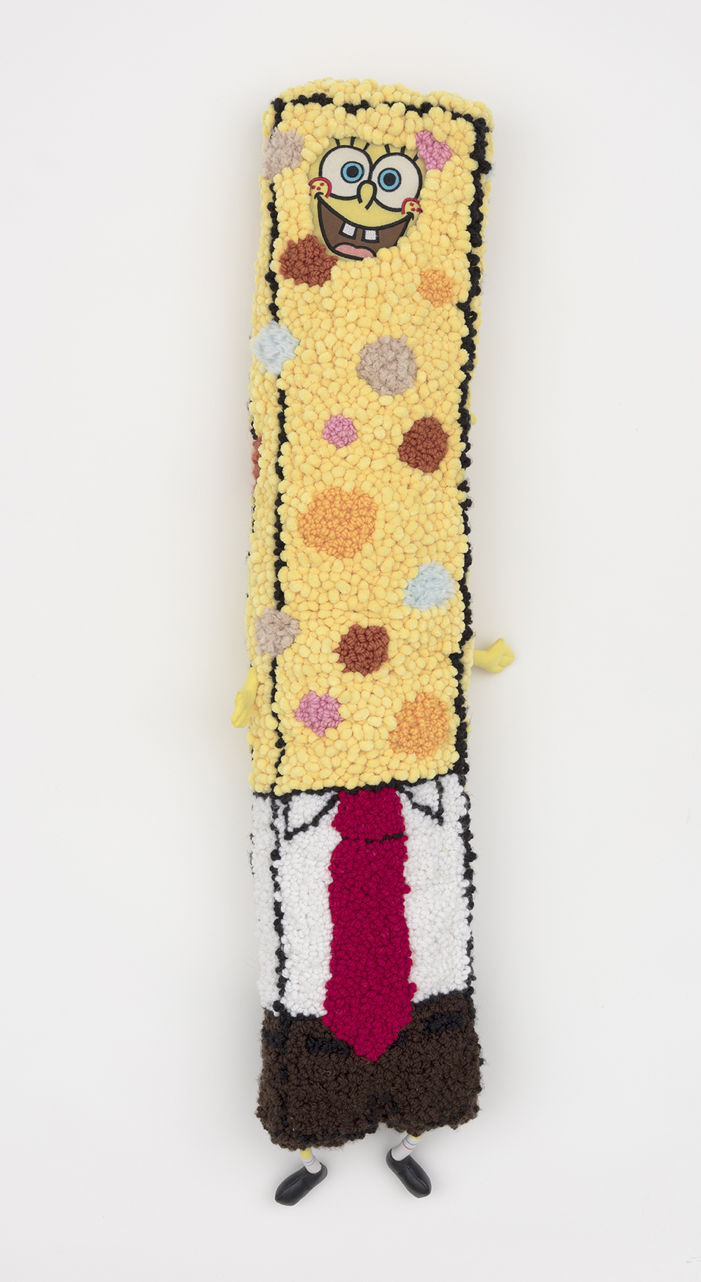 Hannah Epstein. <em>Stretch Bob Square Pants</em>, 2019. Wool, acrylic, burlap, polyfill and found Sponge Bob body parts, 47 x 14 x 4 inches (119.4 x 35.6 x 10.2 cm)