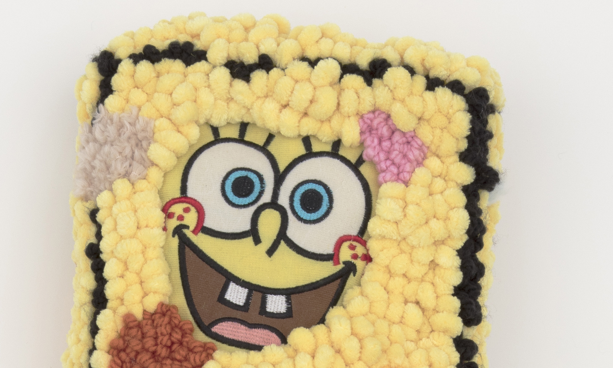 Hannah Epstein. <em>Stretch Bob Square Pants</em>, 2019. Wool, acrylic, burlap, polyfill and found Sponge Bob body parts, 47 x 14 x 4 inches (119.4 x 35.6 x 10.2 cm) Detail