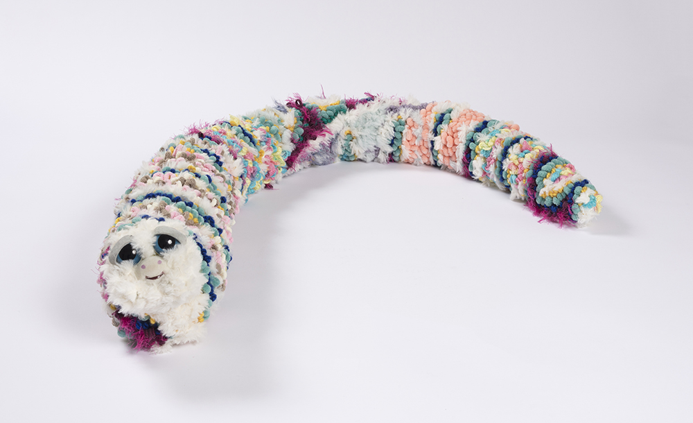 Hannah Epstein. <em>Soft Worm</em>, 2019. Wool, acrylic, burlap, polyfill and found toy parts, 7 x 6 x 56 inches (17.8 x 15.2 x 142.2 cm)
