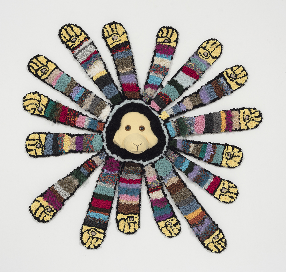 Hannah Epstein. <em>Fists of Furry</em>, 2019. Wool, polyester, cotton, burlap and found llama head, 63 x 62 x 8 inches (160 x 157.5 x 20.3 cm)