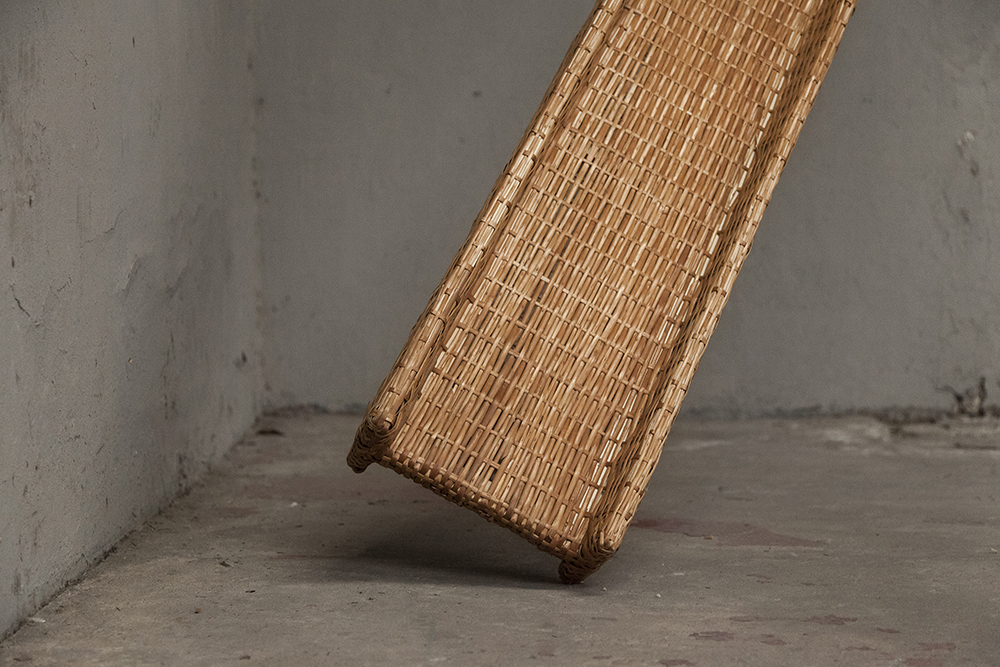 Eugenia Mendoza. <em>Beam</em>, 2018. Wicker and wood, 145 5/8 x 11 3/4 x 7 1/8 inches (370 x 30 x 18 cm) Detail