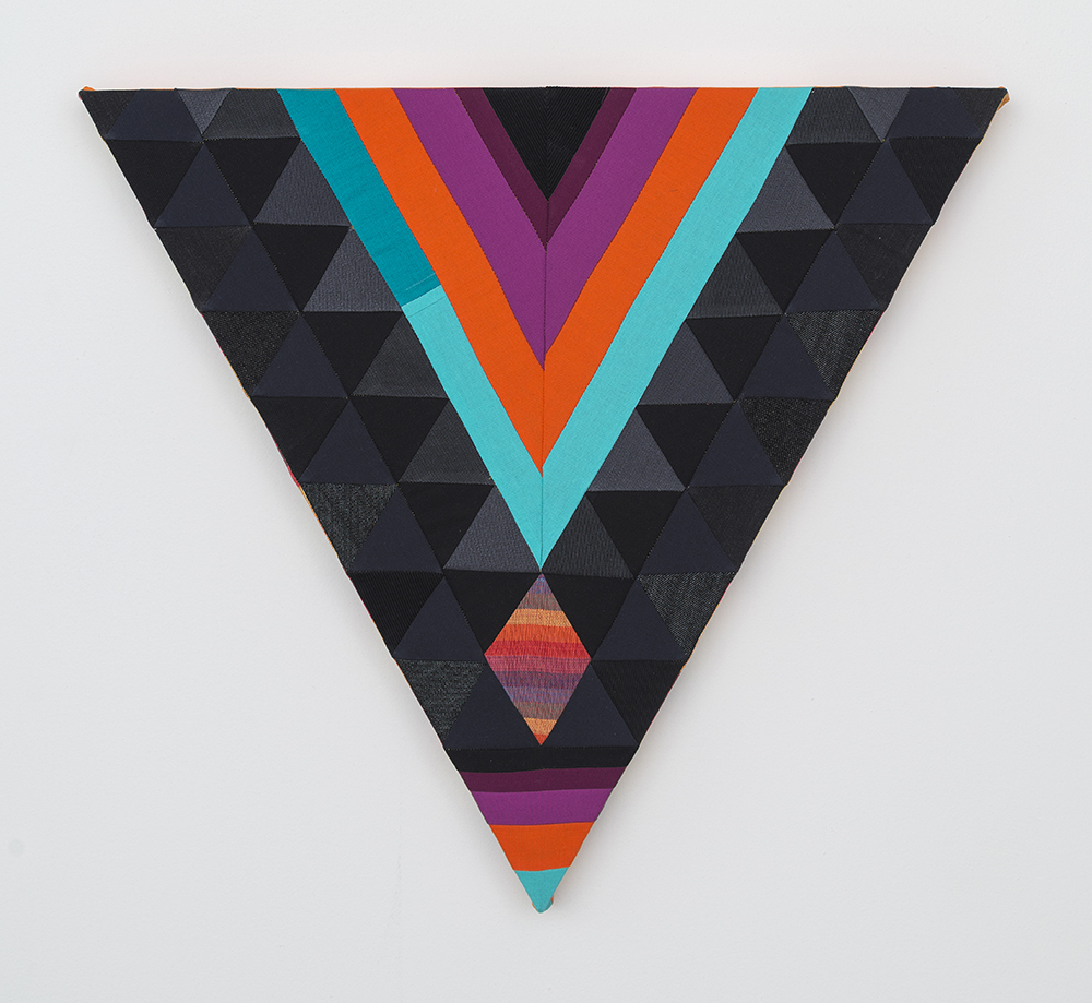 Paolo Arao. <em>Seer</em>, 2020. Sewn cotton, denim, corduroy, canvas and handwoven fibers on shaped wood support, 19 3/4 x 22 inches (50.2 x 55.9 cm)