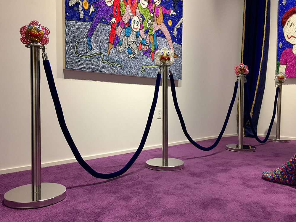 Benjamin Cabral. <em>Guardian (Flowers)</em>, 2020. Rhinestones and epoxy on chrome stanchions with velvet rope, Dimensions variable, each stanchion is 40 x 13 x 13 inches (101.6 x 33 x 33 cm)